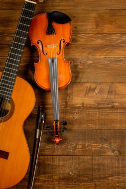 guitar and violin in wood background