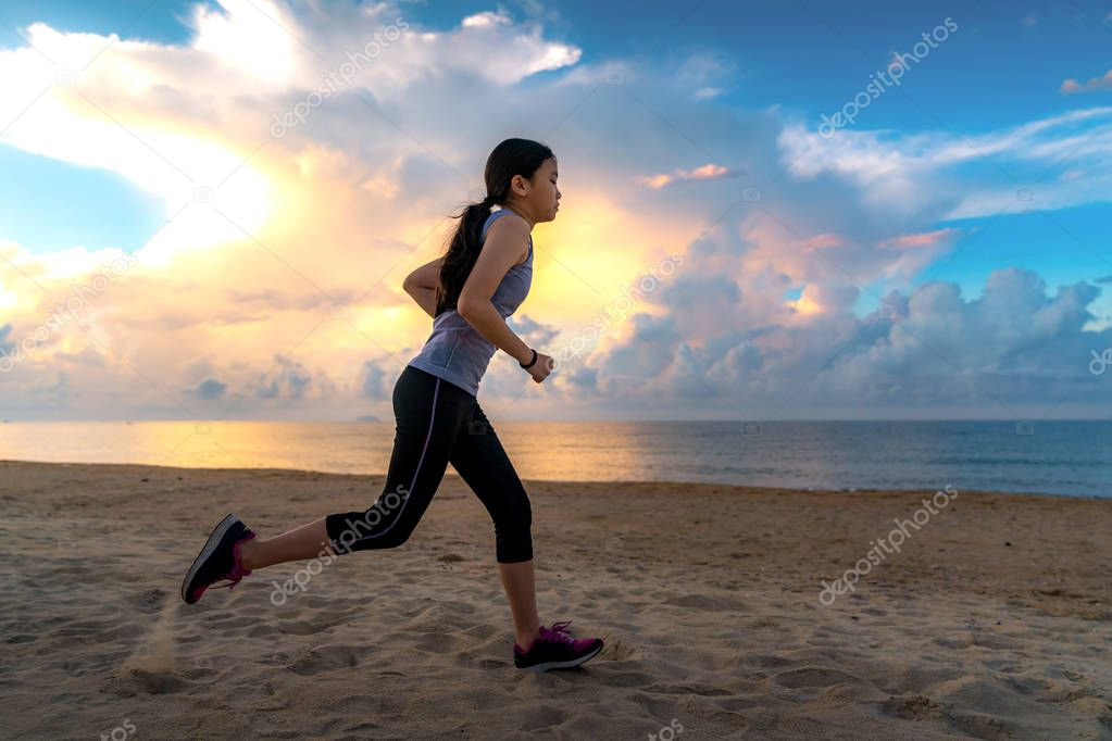Asian girl run on the beach, this immage can use for sport, lifestyle, slim, run and jogging concept