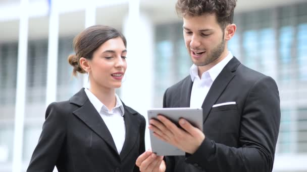 business people using a digital tablet in the city