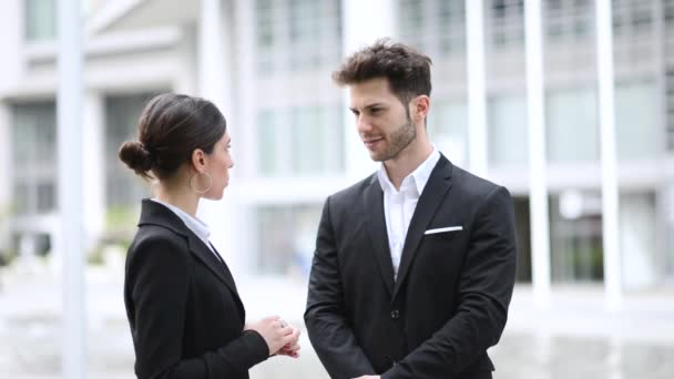 Business partners talking together in the city