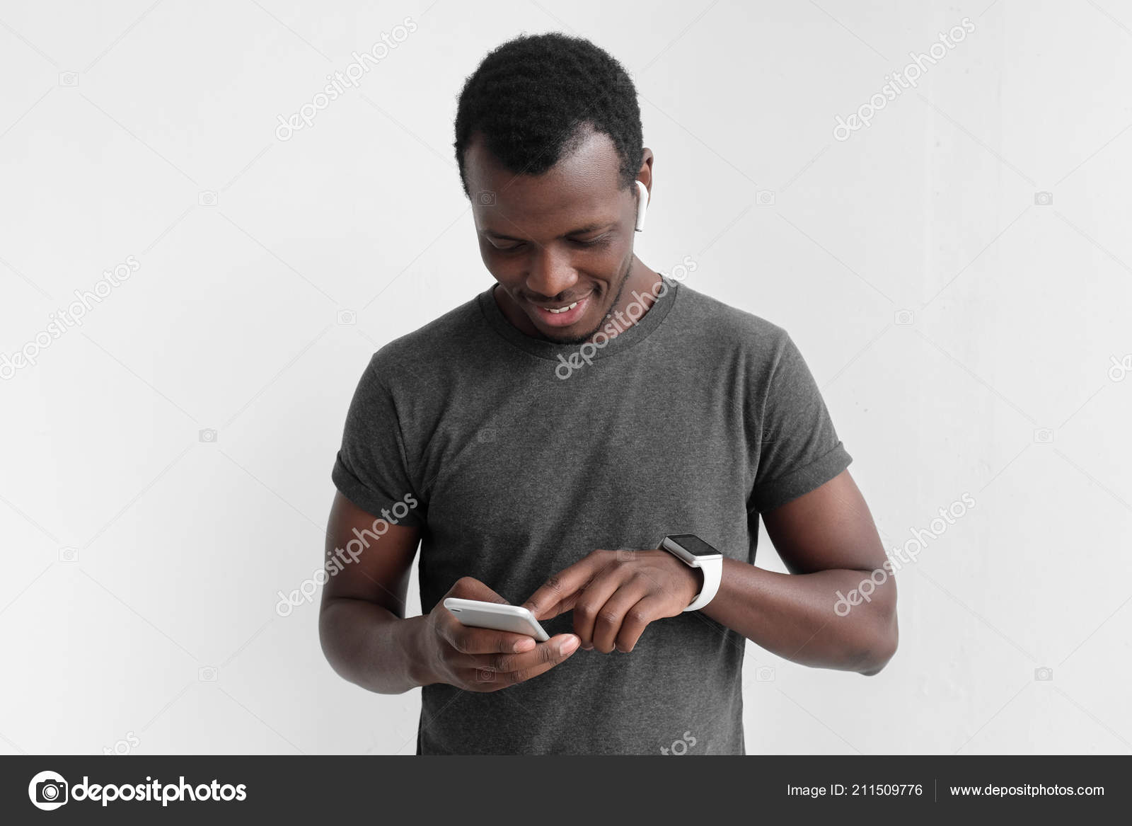 c8f12cf7129 Young african american dark skin man looking at smartphone while texting