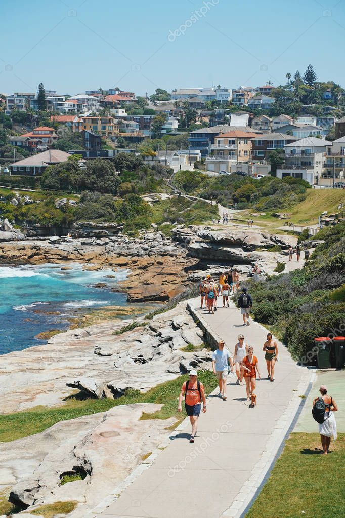 SYDNEY, AUSTRALIA - January 22, 2019: People relaxing on the beach on a beautiful day, Bondi Beach is a famous place in Sydney