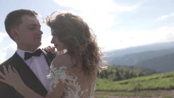 Happy gorgeous bride and groom  in mountains with amazing view