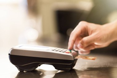 hand and  Credit card payment