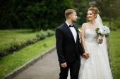 Fotografie newlyweds bride and groom after wedding ceremony.