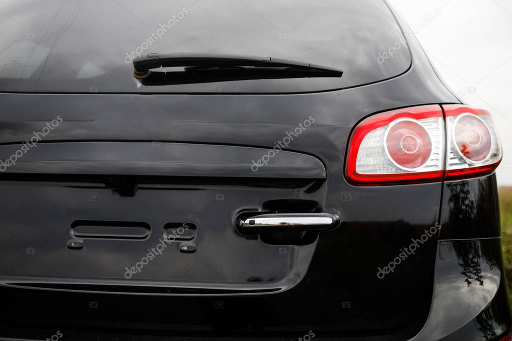 Black premium city crossover, luxury SUV rear light closeup.