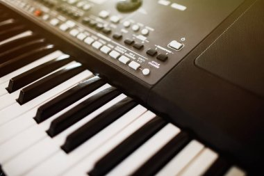 Synthesizer knobs. piano keys close-up. electronic musical instr