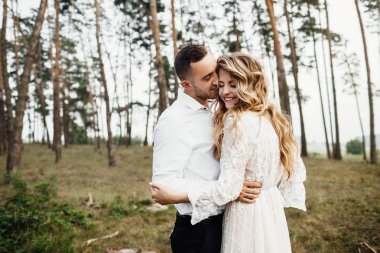 Beautiful couple in love in forest.