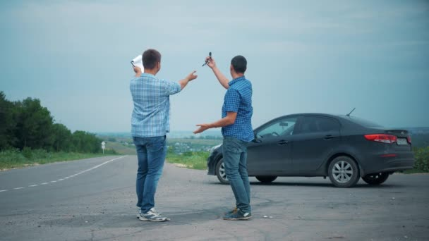 Two men make deal. Buying or rent a car. Car insurance sale of used cars concept. 4K