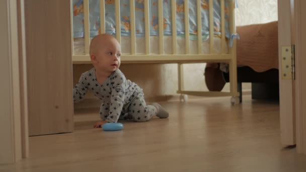 Childhood, kids and people concept - lovely baby boy playing with toys at home.
