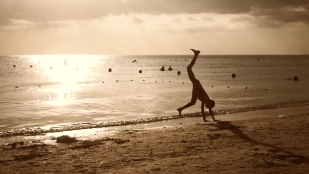 Silhouette beach girl stand on hands lifestyle, summer vacation, beach vacation concept.