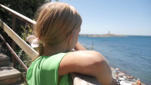 Teen girl watching of sea. Pensive worried girl hoping.