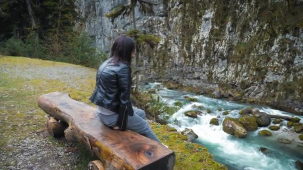 Lady hiker looking on hills and mountain river lake, girl enjoying nature panoramic landscape in trip, relax holiday. Traveler woman exploring woods. travel and wanderlust concept.