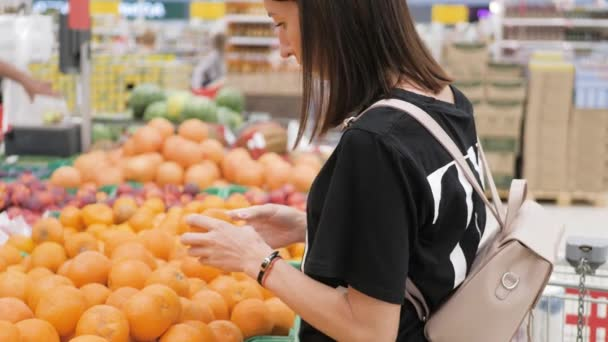 Young woman shopping healthy food in supermarket. Sale, shopping, consumerism and people concept.