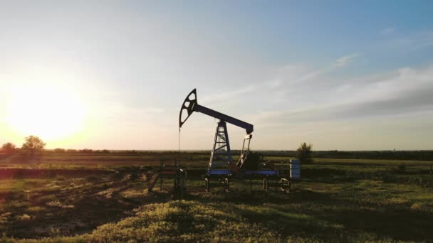 Working oil pump from oil field at sunset. The industrial equipment.