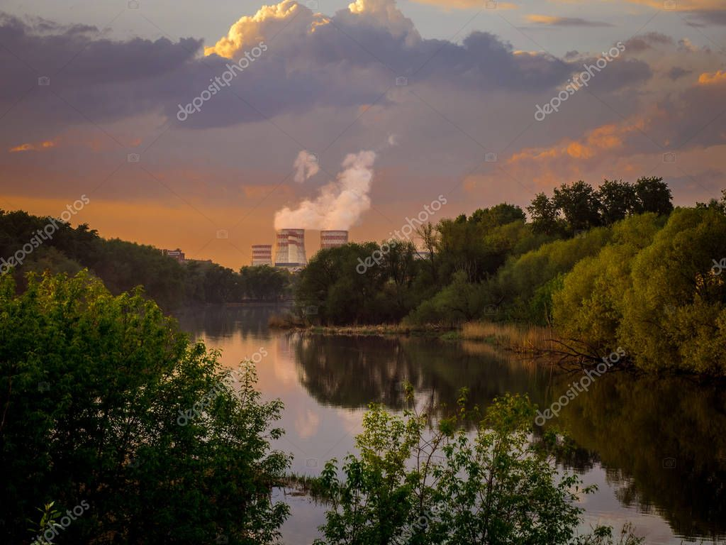 Smoking pipes of thermal power plant against blue sky. Chelyabinsk. Russia.