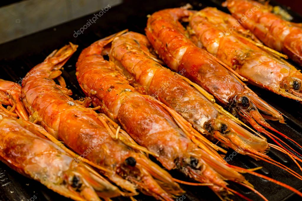 set of large red shrimps Argentinean whole sea delicacies with head group of delicacies on the grill