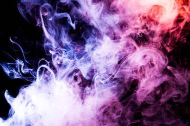 Cloud of pink, purple, blue  smoke on a black isolated background. Background from the smoke of vap