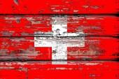 Státní vlajka Švýcarska na nudné dřevěné pozadí