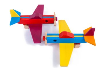 Photo of two wooden multi-colored aircraft from beech. Toy wood retro planes on a white background isolated stock vector