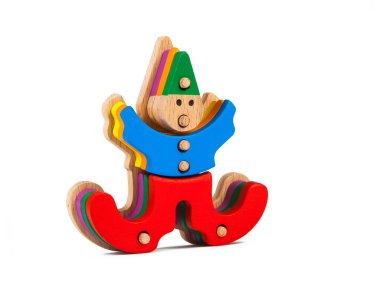 Photo of a wooden toy  children's clown sorter clown-shaped sorter from colorful pieces on a white isolated background. The toy for the development of fine motor child
