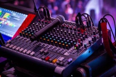 Night club, the concept of nightlife and theatrical life. Professional mixing console at a concert. Remote control for sound engineer. Work place of sound producer at the event stock vector