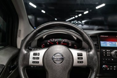 Novosibirsk, Russia - May 23, 2019:  Nissan Pathfinder,close-up of the dashboard, speedometer, tachometer and steering wheel.Photography of a modern car on a parking in Novosibirs