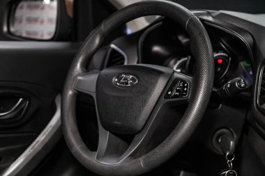Novosibirsk, Russia   June 11, 2019:  LADA XRAY, close-up of the dashboard, speedometer, tachometer and steering wheel. . modern car interio