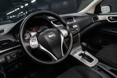 Novosibirsk, Russia  August 01, 2019:  Nissan Tiida, Black luxury car Interior - steering wheel, shift lever, multimedia  systeme, driver seats and dashboard