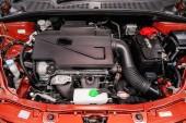 Novosibirsk, Russia  August 24, 2019:  Suzuki SX4, Close up detail of  car engine, front view. Internal combustion engine, car parts, deteyling