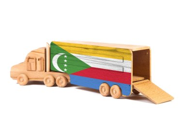Close-up of a wooden toy truck with a painted national flag Comoros. The concept of export-import,transportation, national delivery of goods