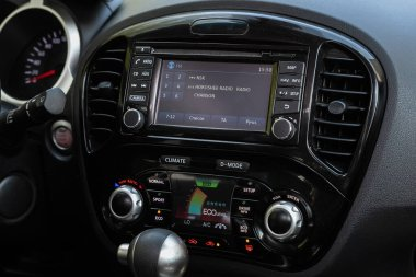 Novosibirsk/ Russia  May 15, 2020: Nissan Juke, close up of the dashboard: adjustment of the blower, air conditioner, player. modern car interior