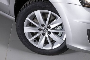 Novosibirsk/ Russia  April 02, 2020: Volkswagen Polo , Car wheel with alloy wheel and new rubber on a car closeup. Wheel tuning disk stock vector