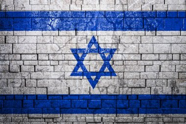 National flag of Israel on brick  wall background.The concept of national pride and symbol of the country. Flag  banner on  stone texture background.