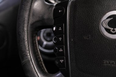 Novosibirsk/ Russia  June 10 2020: SsangYong Rexton, New black steering wheel with multifunction buttons for quick control phone, music and other function