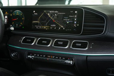 Novosibirsk/ Russia  April 28 2020: Mercedes Benz GLE-class, close-up of the central dashboard, monitor with music and radio , adjustment of the blower, air conditioner, player. Inside car