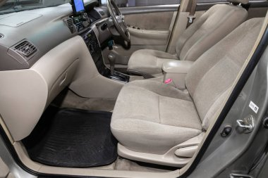Novosibirsk/ Russia  June  23 2020: Toyota Corolla, Prestige car interior with dashboard, steering wheel, speedometer and tachometer. Black leather interior