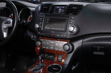 Novosibirsk/ Russia  April 28 2020: Toyota Highlander, close-up of the dashboard, player, steering wheel, accelerator handle, buttons, seats. modern car interior: parts, buttons, knob