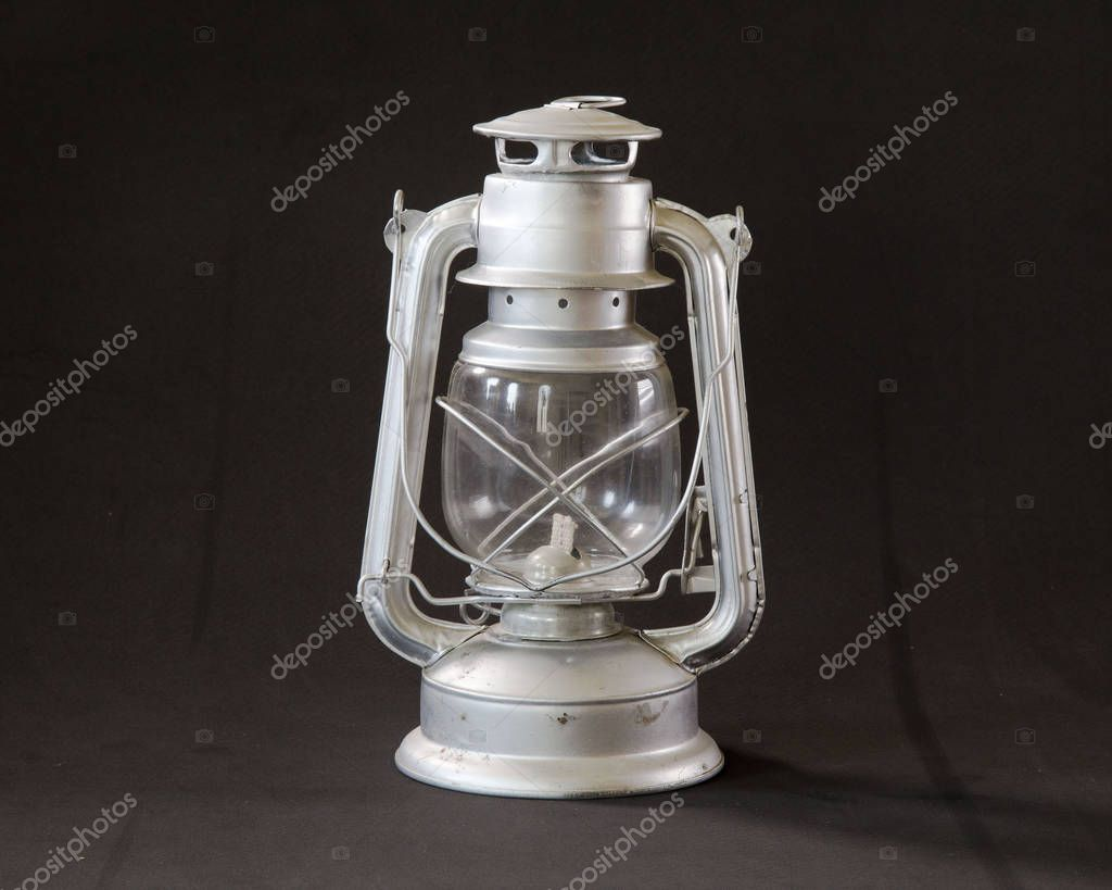An elegant oil lamp from puebla on a dark background