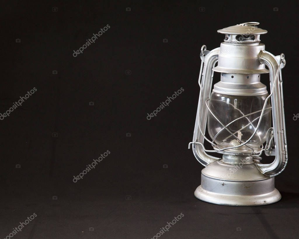 An elegant oil lamp from puebla on a dark background in a middle shot