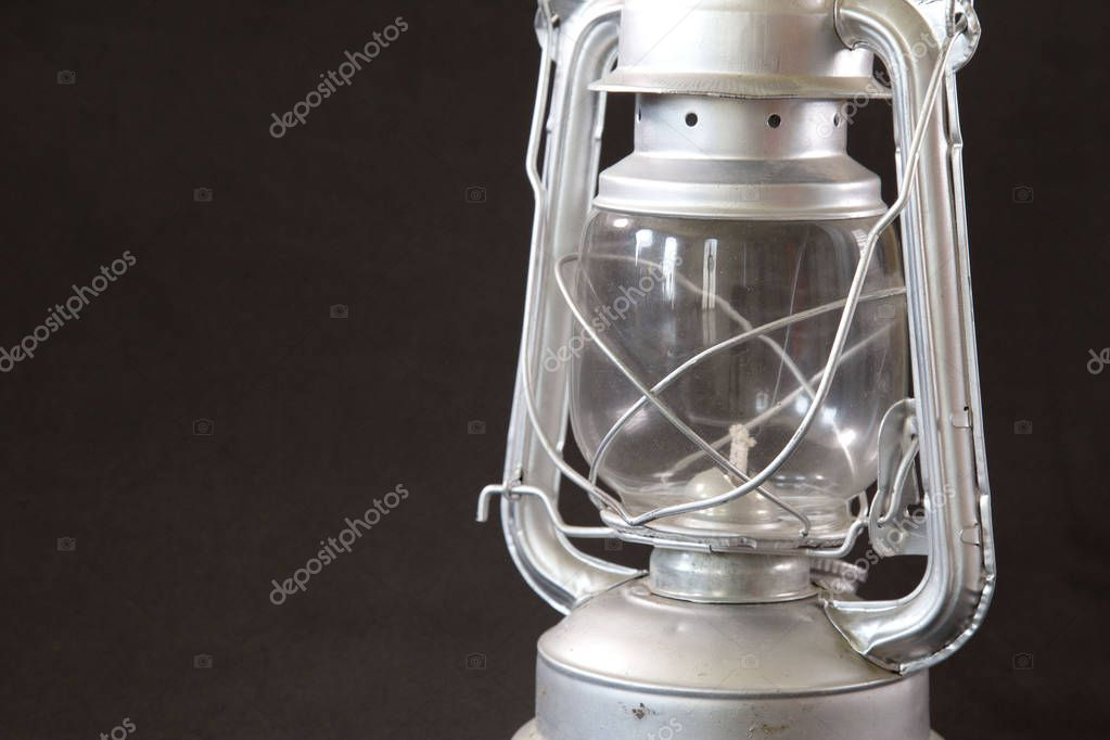 An elegant oil lamp from puebla on a dark background in a close up