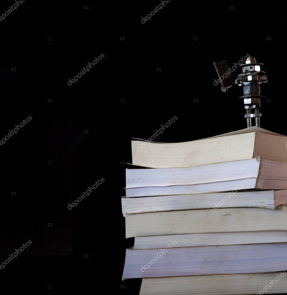 Cultural Robot Reader on a pile of books of all the knowledge of the world maybe Multivac finally met its match
