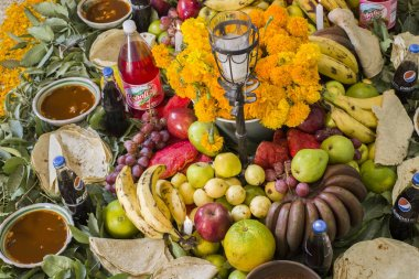 Traditional day of the dead, altar with dead bread, flowers, food and candles. Party celebrated throughout Mexico on October 31, November 1 and 2