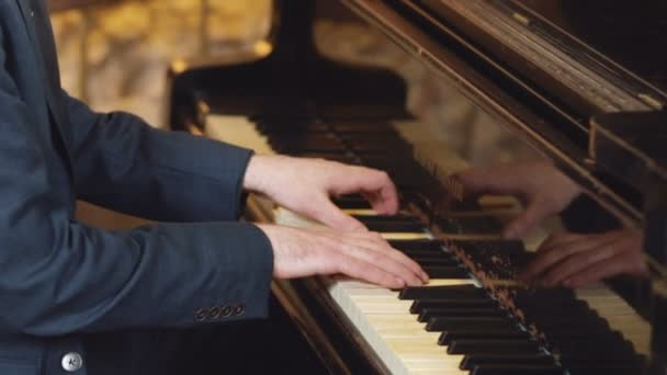 Playing classic piano. Professional musician pianist. Hand