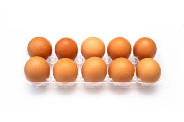 Chicken eggs in plastic package on white background.
