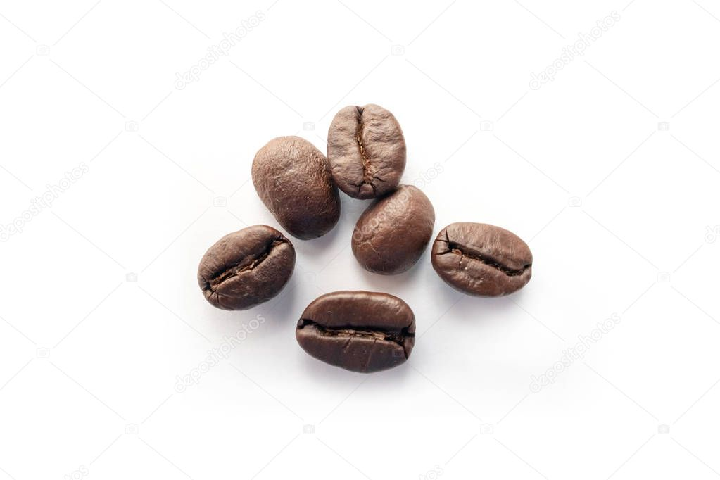 Roasted coffee beans isolated on white background. Close up.