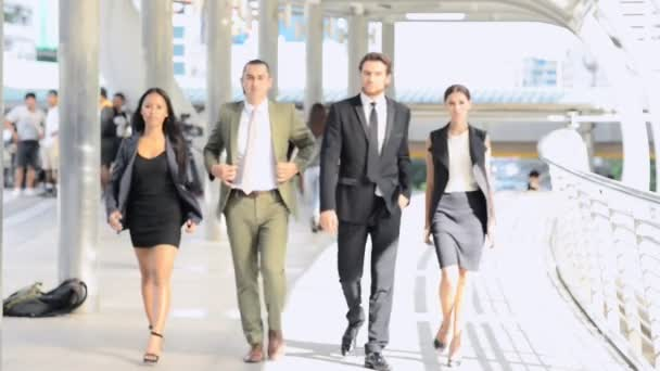 Young business leader portrait. Portrait of mixed race confidence businessman and woman walking toward camera with confidence posture. Business leader and young business leader career concept.