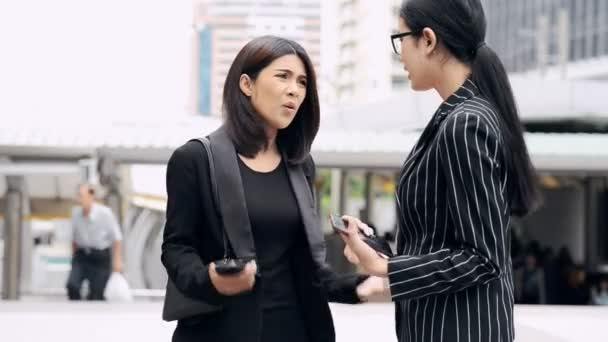 Young generation business team not working together concept. Young business intern Asian woman having very serious fight and arguments with her Asian female manager, dramatic expression. Medium shot.