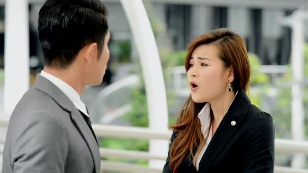 Young generation business team not working together concept. Young business intern Asian woman having very serious fight and arguments with her Asian male manager, with dramatic expression.