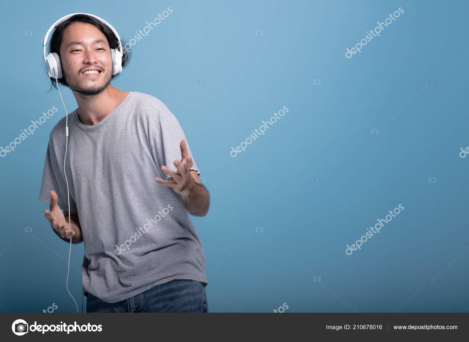 Young Bearded Man Listening Music Blue Background Happy